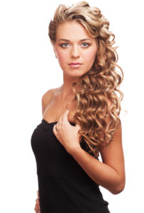 Portrait of attractive young woman with long blond hair and bea